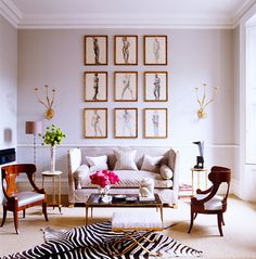 17 Beautifully Feminine Rooms to Get Inspired By// zebra hide, art grid