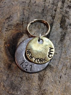 This custom keychain will be stamped with your run distance and the city or date. This could also be sent to you as a pendant. In the Notes to Seller section, be sure to give me your race details. This is also where youd let me know if youre choosing the pendant instead of the keychain. Check the last picture for font choices. The font used on the brass washer is font #6. Please remember that each letter is hand stamped, so placement may vary slightly. This only adds to the charm of your…