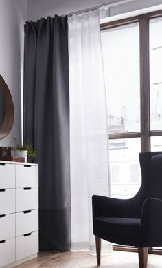 Layering a black-out curtain with a sheer curtain lets you decide how much light you want to let in while keeping things private.