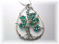 Interesting tree of life...Like the organic shape and the silver beads!