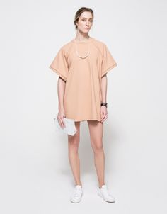 From Stelen, an oversized mini dress with minimalist styling in classic colors. Features crew neckline, raglan sleeves, short sleeves, wide sleeves, on seam side pockets, straight hem, mini length, relaxed fit and square silhouette.  •Boxy mini dress i