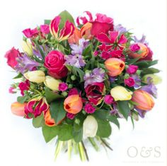 Valentine's Day colourful and bright mixed bouquet. Gorgeous flowers in pinks, orange, yellow and purple, including roses, tulips, gloriosa and alstroemeria by London based Floral Designers Okishima & Simmonds. www.okishimasimmonds.com