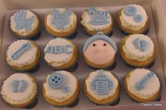 Baby boy themed cupcakes  www.creationcakes.org.uk