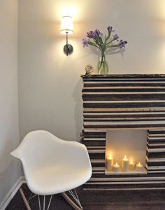 How To: DIY a Faux Fireplace  -  http://www.apartmenttherapy.com/diy-faux-fireplace-before-afte-96972#