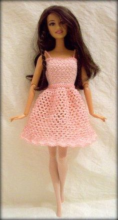 Crochet Dolls Clothes Pink Crochet Dress for Barbie Doll More Watch This Video Incredible Crochet a Bear Ideas. Cutest Crochet a Bear Ideas. Crochet Doll Dress, Crochet Barbie Clothes, Doll Clothes Barbie, Barbie Dress, Knitted Dolls, Barbie Doll, Knitting Dolls Clothes, Knitting Toys, Crochet Dresses