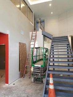 Stairs (not yet finished) leading from our leasing center up to the business center! July 11th