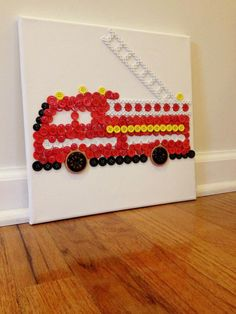 Fire truck made out of buttons by me