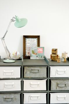 styling: industrial drawers +  mix  + those little robots are so cute ( JESSICA-DESIGNLEMONADE)
