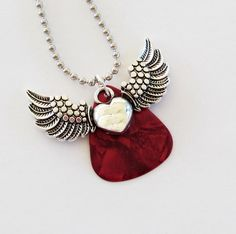 Guitar Pick Necklace Winged Heart Red by susanwilliamsdesigns Guitar String Jewelry, Guitar Pick Jewelry, Guitar Pick Necklace, Music Jewelry, Jewelry Crafts, Jewelry Art, Jewelry Accessories, Handmade Jewelry, Jewelry Design