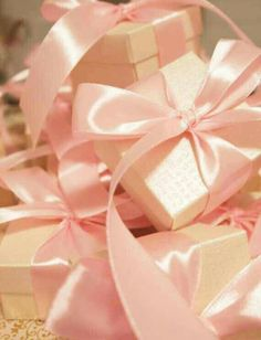Guvon loves pink ribbons...and small boxes...