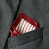 Silk red pocket square featuring a classic striped pattern. Add a touch of colour and style with this 100% silk pocket square.     Dimensions: 20cm x 20cm