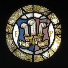 An English glass panel, c.1540, displays the heraldic badge of Edward Tudor, then the prince of Wales: three white ostrich feathers with the motto 'Ich Dien' (Here spelled 'Dein'. (Victoria & Albert Museum)