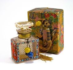 1920s Vantines Hana Violet perfume bottle and stopper, clear glass, fabric, soutache trim, and Peking glass decoration, label, box with glass bead closure. 2 3/4 in.