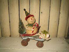 Snowman on vintage roller skate