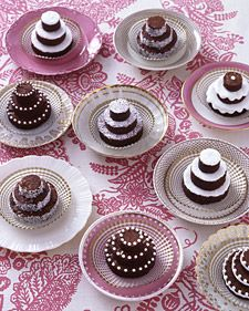 Tiny Brownie Treats. Stacked mini brownie cakes can replace a wedding cake or be part of the dessert buffet. Set on mismatched china, they are decorated with royal icing, sanding sugar, grated coconut, and confectioners' sugar. Inside-out cupcake liners serve as doilies. No recipe.