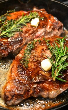 **Butter-Basted Rib Eye Steak This steak is based on a recipe from Alain Ducasse. Halfway through cooking, these bone-in rib eyes are basted with a mixture of butter, thyme and garlic, so they're crusty outside and richly flavored.   adapted from Food & Wine