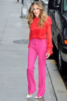September 7, 2011  Parker gives a lesson in color-blocking in a bright red Prabal Gurung blouse and pink wool pants.