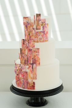 Three Tier White Cake With Art Painting Detailhttps://www.thecelebrationsociety.com/weddings/modern-art-gallery-wedding-ideas-jepson-center-arts-savannah-ga/