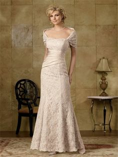 Elegant mermaid long champagne lace mother of the bride dress with a wrap