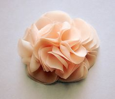 DIY- Fabric Hair Flowers, this link gives basic instructions and a link to the full tutorial...