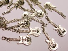 Guitar Silver color charms hypoallergenic- 20 pcs -  small guitar charms. $1.99, via Etsy.