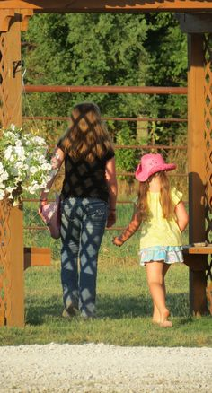 Young guests at the church barbecue take a walk through the Rose Arbor at the east end of the Courtyard at Westwoods' Civil War Ranch. (Pictures by Lena & Leif Baron)