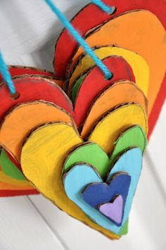 Layered painted cardboard hearts