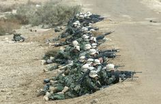 U.S. Marines from Task Force Tarawa battled with Iraqi troops March 24, 2003 in the southern Iraqi city of Nasiriyah. The Marines had running gun battles over the past two days with a stubborn resistance within and around the city. (Photo by Joe Raedle/Getty Images)