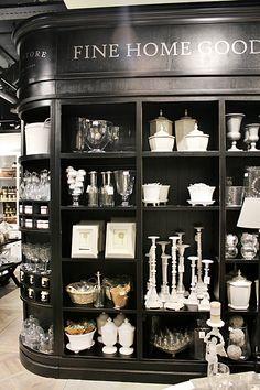 (A través de CASA REINAL) >>>>>  Black shelving with trim and mouldings for merchandise displays.