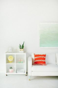 All white living room + DIY watercolor wall art