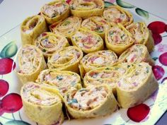 Chicken Enchilada Dip Roll-ups  2 (8 oz.) packages of cream cheese, softened (I used low fat) 1 1/3 cup shredded Mexican blend cheese (I use...