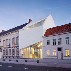 City Hall Harelbeke by Dehullu & Partners. This asymmetric white building bridges the two existing halves of a town hall in the Belgian municipality of Harelbeke.