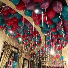 Balloon Ceiling, a simple and effective way to add color and fun to any party. #partywithballoons
