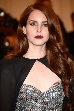 LANA DEL REY This redheaded crooner makes us swoon thanks to her haunting voice and retro-style waves.