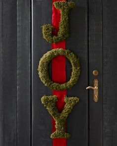 love the hardware and color of the door! Available in every letter of the alphabet, this moss-covered wreath alternative invokes the distinctive charm found in Ireland's quaint coun. Valentine Day Wreaths, Holiday Wreaths, Holiday Fun, Holiday Ideas, Holiday Style, Winter Holiday, Moss Covered Letters, Moss Letters, Noel Christmas
