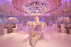 wait i love this!! if only they used orchids. just add my tree centerpieces. i love this lighting too.