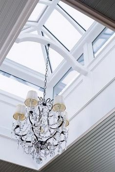 Chandelier hanging in roof lantern skylight Dining Room Furniture, Dining Room Table, Dining Area, Roof Lantern, Roof Light, Glass Roof, House Extensions, Hanging Lights, Hanging Chandelier