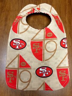 A personal favorite from my Etsy shop https://www.etsy.com/listing/253590483/san-francisco-49ers-retro-baby-bib