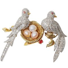 Diamond Encrusted Doves Nesting Brooch USA Circa 1940s 18kt yellow and white gold brooch with doves nesting with pearls and diamonds and ruby accents.