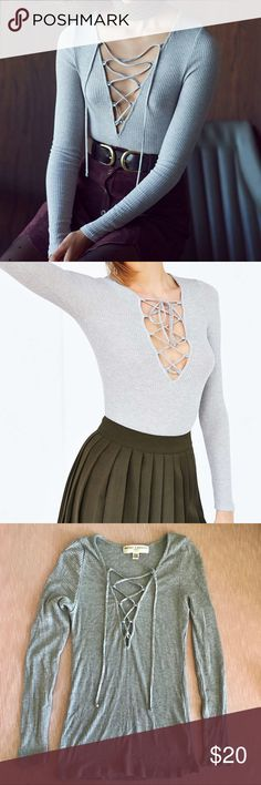 Urban Outfitters Lace Up Long-sleeve Project Social T for Urban Outfitters. Lace up grey knit long sleeved shirt. Tight and stretchy fit. Laces can be left hanging or tied into a bow and are fully adjustable. Super cute tucked into skirts and jeans! Size medium. In perfect condition. Urban Outfitters Tops Tees - Long Sleeve