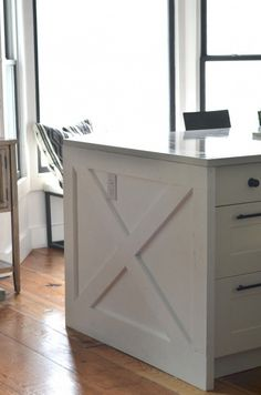 kitchen island end ... X Marks the Spot -- waterfall countertop ... with diy x cabinet end cap