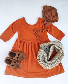 The perfect comfy, cozy Fall outfit! Find our Rust Swing Dress at vivieandash.com.