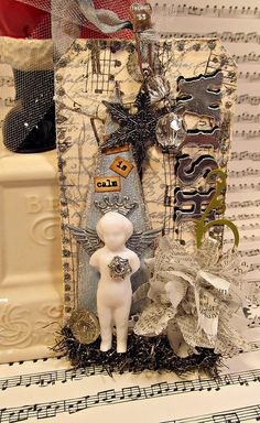 Tim Holtz Frozen Charlotte Doll Christmas Tag, created by The Gentleman Crafter.