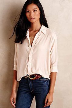 Classic, clean top, fabric quality shows.  I like the lack of buttons down the front. Put this in a rose or creme color and i'd even do neutrals.