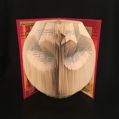 This Star Wars book titled Planet of Twilight has been folded to display the Rebel Alliance symbol. The original dust jacket has been repurposed on the inside covers. The outside of the book is red, and a Darth Vader illustration has been added to the front.  The covers measure around 9.5 inches tall, and almost 6 wide. When on display, the book fans out to around 10-12.  This is a brand new design for 2017 and is ready to ship TODAY! We ship with 1-3 day Priority Mail.