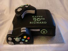 Black X-Box 360 Fondant Cake - (Feb 2013) This was my first attempt at making this cake. I had a bit of gravity problems with the front controller. Covered the cake in White fondant and then painted it with black colour paste mixed with Dipping Solution. Making this cake for another client next week so hopefully it will look better. Hope you enjoy it!! xMCx