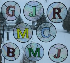 Stained Glass Letters - there's a germ of an idea here for Library -- letters in glass-- hrm.