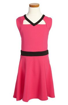 A Sally Miller dress that Chloe Lukasiak once wore to the kids choice awards. a pink dress with a black belt and a black v-neck with a flowy bottom and top of the dress.