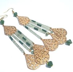 Luscious dew drop Swarovski crystal & brass filigree #chandelier #earrings. A beautiful accent for a bride or her bridesmaids by Etelage.