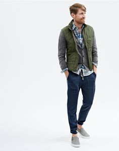 J.Crew men's broadmoor quilted vest, cotton cardigan sweater, sweatpant, chamois elbow-patch shirt, and Vans suede slip-on sneaker.